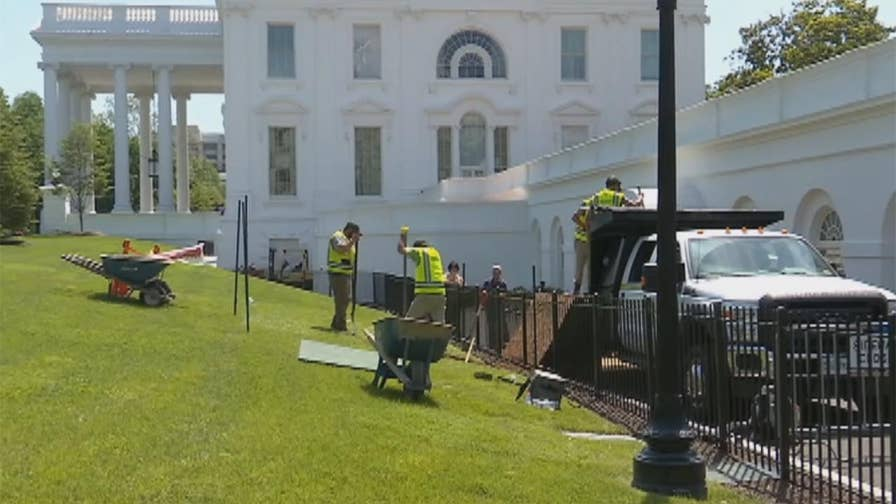 Raw video: Workers fill in hole that developed on White House grounds.