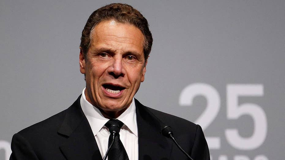 New York governor issues pardons to let parolees vote
