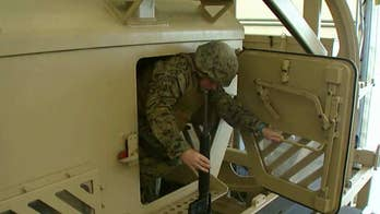 Training scenarios help service members know how to respond if an armored vehicle rolls over.