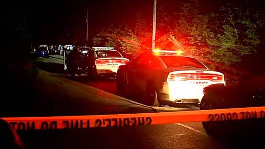 Raw video: Police arrive to investigate the scene.