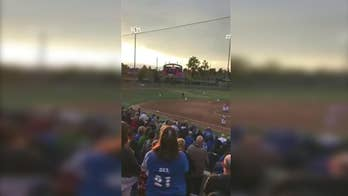 Raw video: Crowd at California baseball game sings the national anthem.