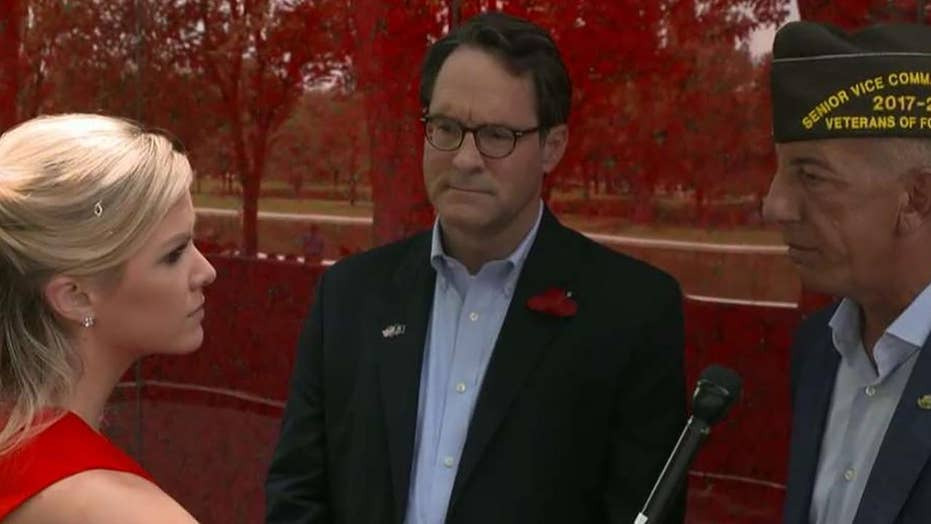 Wall of poppies displayed in honor of fallen service members