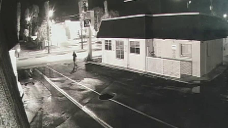Security camera footage shows a man swinging a 2x4 at a Little Caesars employee as he's leaving the shop.