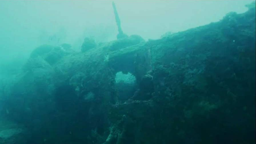 Heaven Can Wait B-24 bomber was shot down in 1944 and lay hidden off the coast of Papua New Guinea until its discovery by Project Recover; Claudia Cowan reports from Livermore, California.