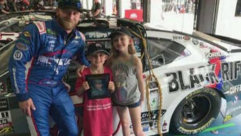 NASCAR driver does something special for late veteran's children.