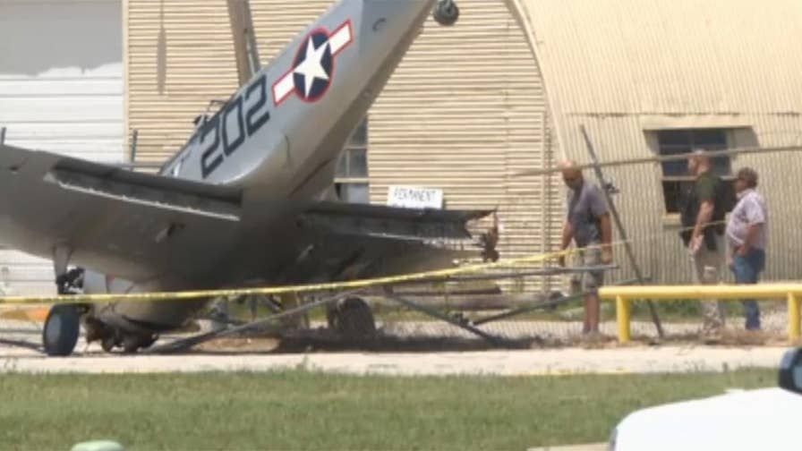 Raw video: Pilot and passenger suffer minor cuts in crash where plane struck a pole and broke off a wing in Wichita, Kansas.