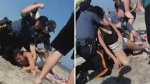 Ernie Troiano admits he was stunned by the footage of police in Wildwood, New Jersey punching a woman twice and putting her in a chokehold, but says the officers were 'understanding of what they did.'