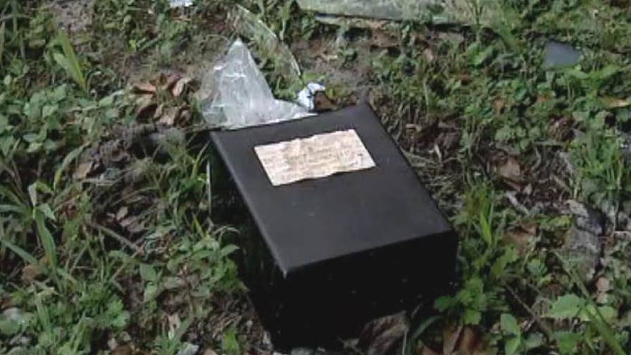 Houston woman finds human ashes tossed on the side of the road.