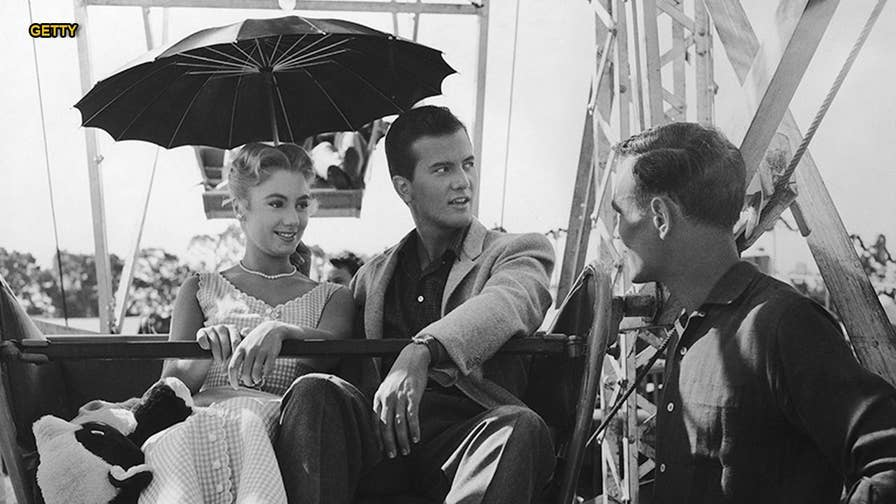 Celebrated singer and actor Pat Boone recalls when he was asked to kiss Shirley Jones in his 1957 musical romance film 'April Love.' It was the first time he was asked to pucker up for a paycheck and the 'near-kiss' certainly stirred headlines.