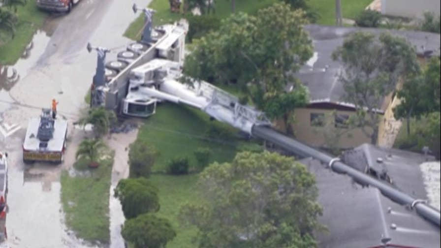 Authorities say the crane was being used for a power pole installation in Lauderhill, Fla.