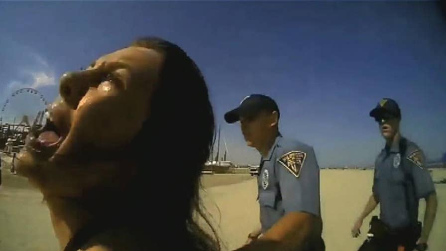 Body camera footage reveals a physical altercation that took place on Wildwood Beach between New Jersey police officer and woman.
