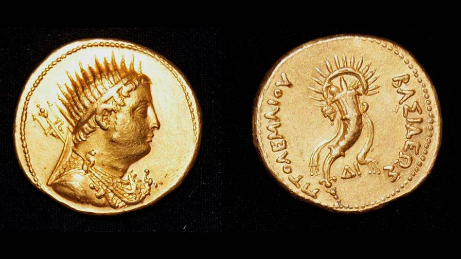Egyptian archaeologists uncover a rare coin in an ancient red brick building found in Egypt. The coin depicts the 3rd century BC ruler, King Ptolemy III.