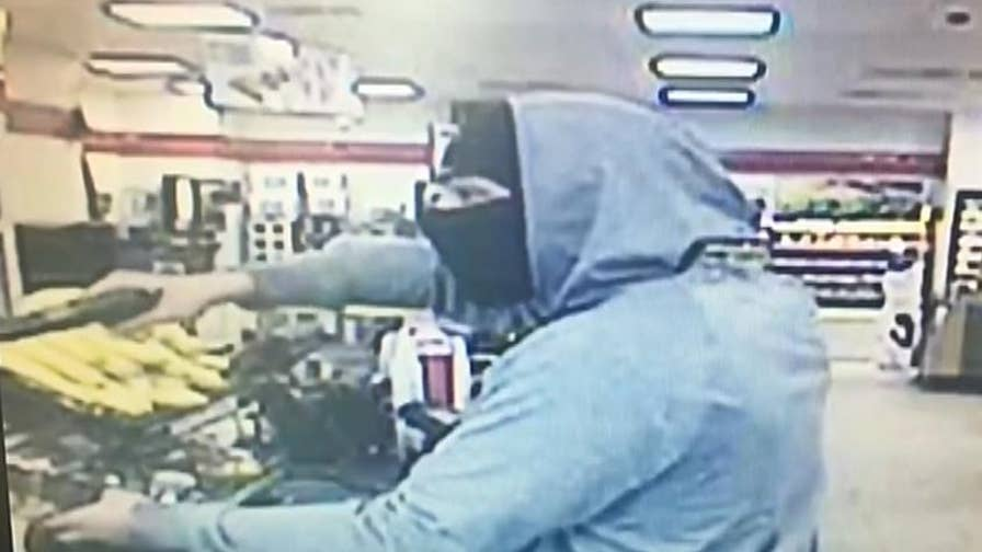 Surveillance video shows armed robbery in Maryland 7-Eleven. Investigators are asking the public's help in identifying the suspect.