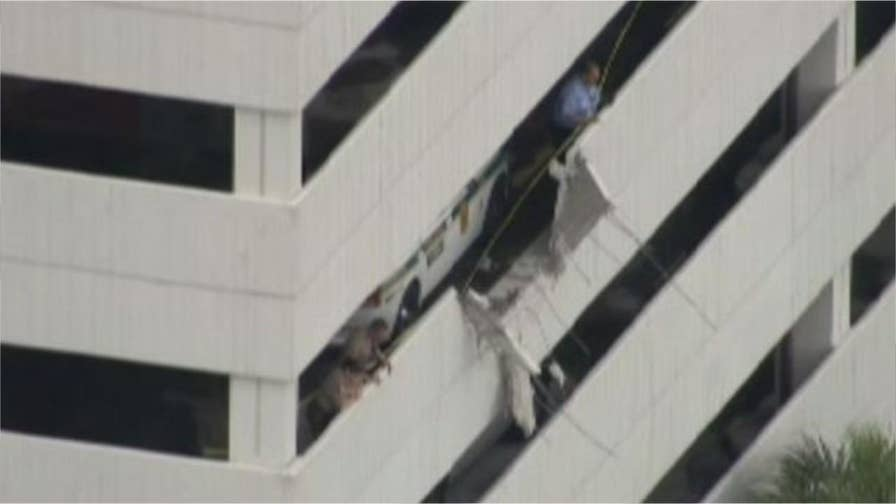 An American Airlines van plunged off the 4th-floor garage at Miami International Airport.