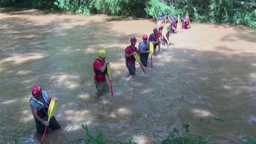 The teens were swept away by an overflowing creek.