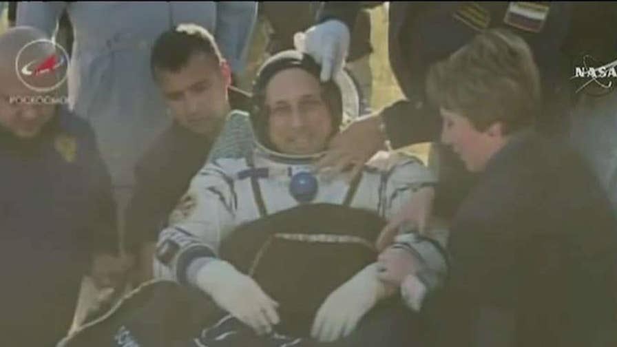 The astronauts touched down in Kazakhstan.