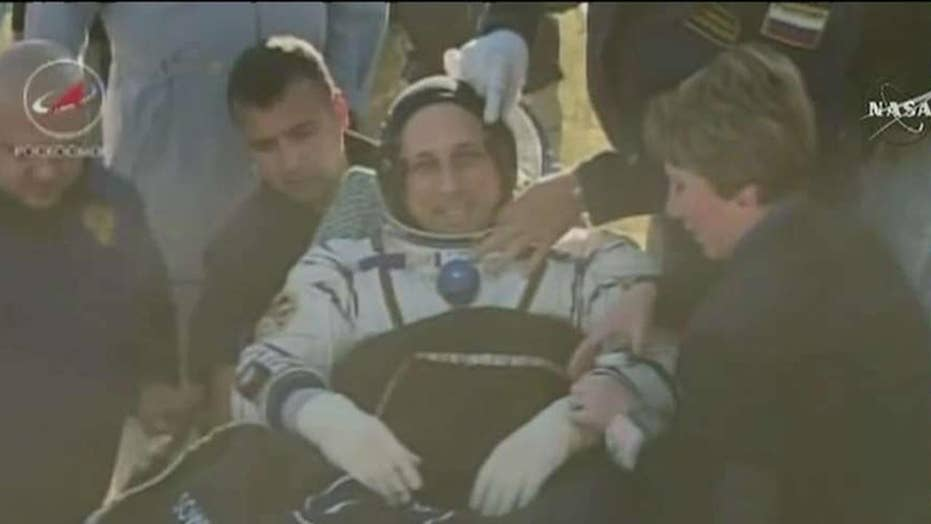 Three astronauts return home from the ISS