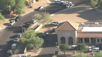 Scottsdale SWAT teams surrounded a motel, found that the unidentified man had shot himself.