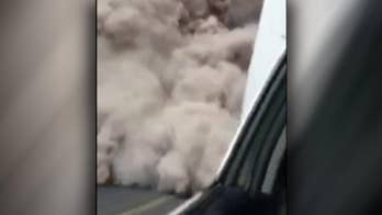 Raw video shows Guatemalan police fleeing the rapidly expanding ash cloud from a volcanic eruption.