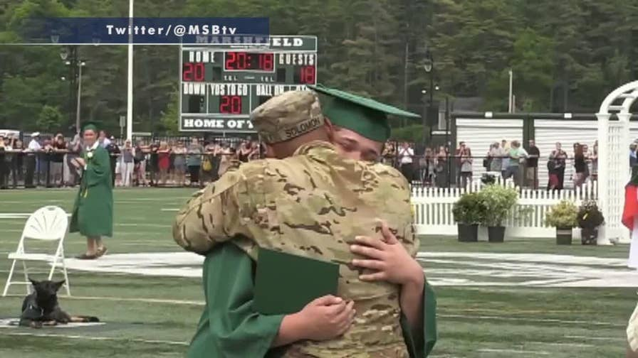 High school graduate Tyler Solomon is surprised by his father after deployment.
