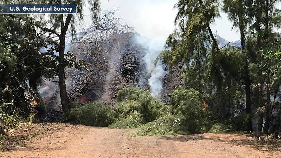 Authorities say as many as a dozen residents who decided not to evacuate are now cut off from power, water; Jeff Paul reports from Pahoa, Hawaii.