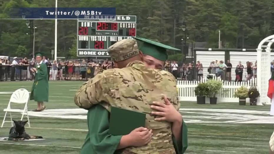Military father surprises son at high school graduation