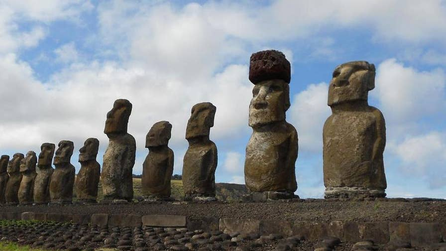 Researchers say they figured out how the ancient people of Easter Island put 12-ton hats on the mysterious statues.