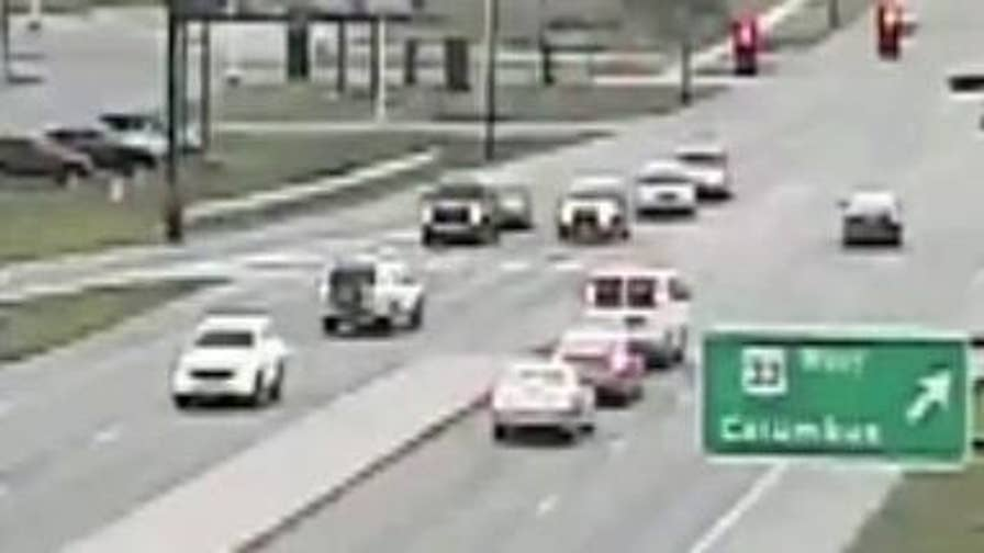 Raw video: The Ohio Department of Transportation releases surveillance video showing car driving backwards. No injuries were reported related to this incident.