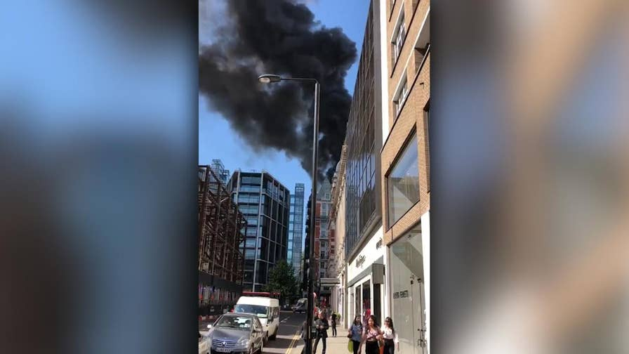 Raw video: Plumes of smoke seen coming from the Mandarin Oriental Hotel in Knightsbridge.