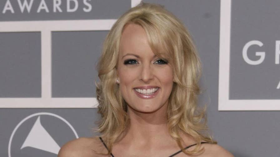 Adult film star accuses Keith Davidson of colluding with President Trump's personal attorney, Michael Cohen, to have Daniels publicly refute her claim that she had a sexual relationship with Trump.