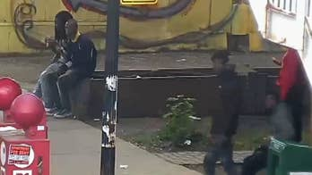 Surveillance video shows men prior to a shooting involving a Chicago police officer in Bronzeville.
