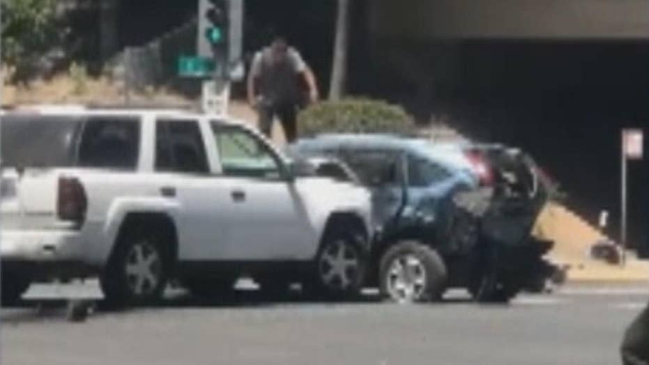 Driver rams SUV, stomps on roof in wild road rage incident