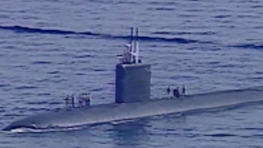 U.S. officials say hackers targeted a Navy contractor and stole a massive amount of sensitive data on undersea warfare from his computers.