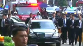 Kim Jong Un arrived in Singapore on Sunday for the historic summit with President Trump — and brought his army of bodyguards along with him.