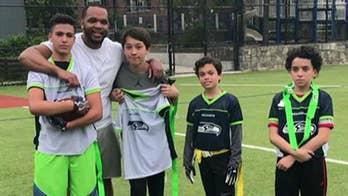 Kimberly's son Ronan and Seahawks team win NFL and U1 Sports flag football championship.