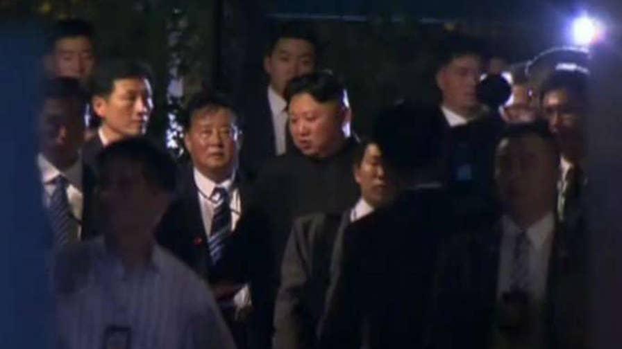 North Korean leader seen leaving hotel on foot ahead of meeting with President Trump.