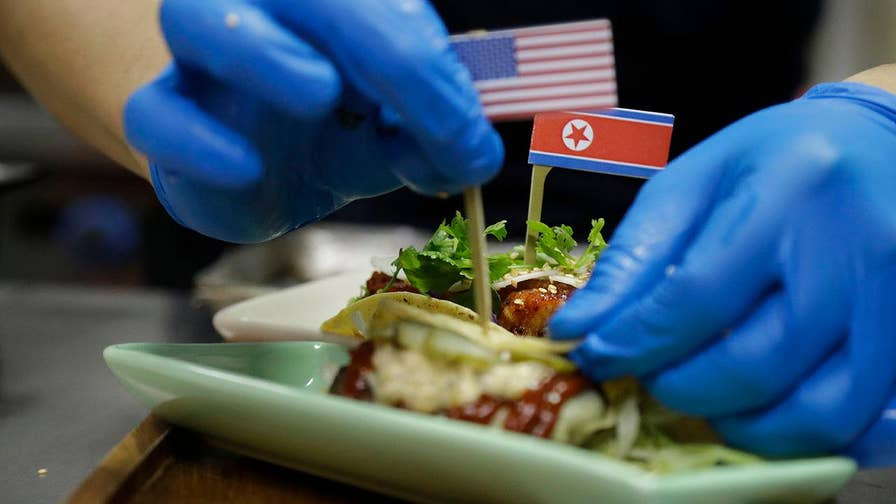 Singapore restaurants are cashing in on Trump's historical meeting with North Korean leader Kim Jong Un, serving up everything from red, white and blue cocktails to tacos named after the two leaders.