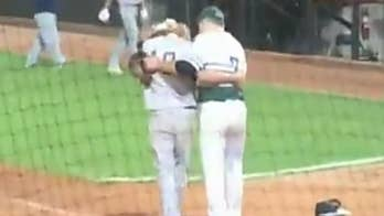 Minnesota high school pitcher consoles childhood friend after striking him out to reach state championship.