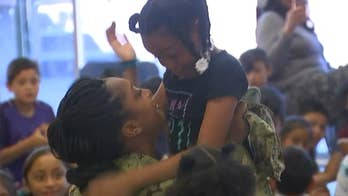 California military mom surprises her third grade daughter at her school's year-end assembly after 10-month deployment in Afghanistan.