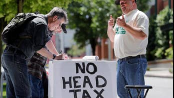 City leaders in Seattle will vote on repealing a controversial 'head tax' which received fierce backlash from companies like Amazon and Starbucks; Dan Springer reports from Seattle.