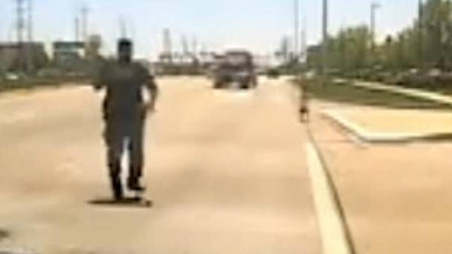 Dash cam footage shows a police sergeant rescuing a child running along the road near Chicago.