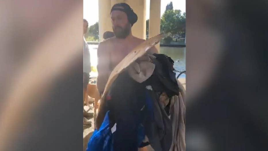 Jogger throws homeless man's belongings into lake, trash