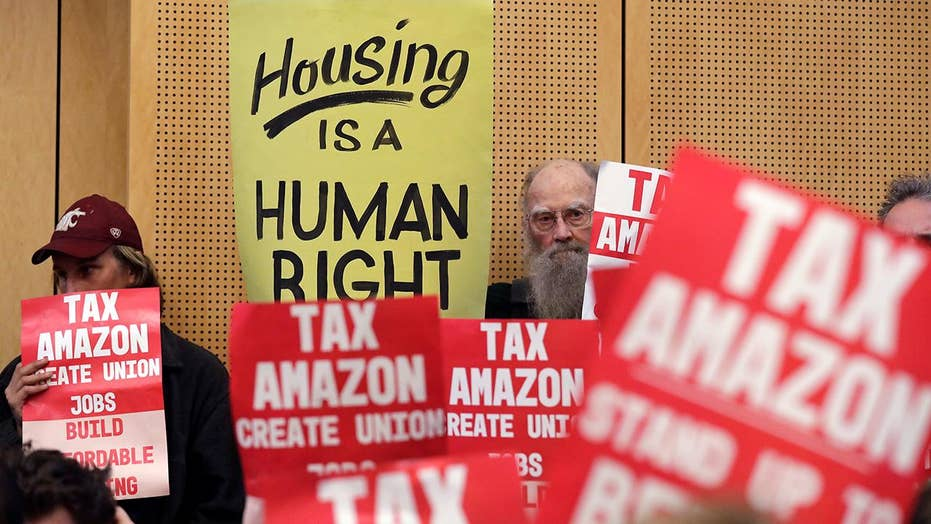Seattle backs off new tax on big businesses