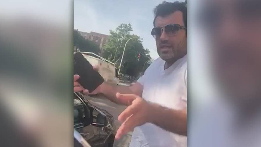 Raw video: Couple says driver kicked them out of his car for kissing during ride from Brooklyn to Manhattan.