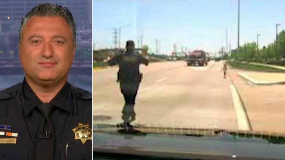 Hero cop saves toddler wandering into traffic