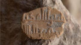 Archaeologists in Israel have unearthed an extremely rare ancient clay amulet with a blessing in Arabic.