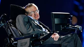 The voice of Stephen Hawking will be beamed into space in a message of peace and hope as the British physicist was laid to rest during a service at London's Westminster abbey.