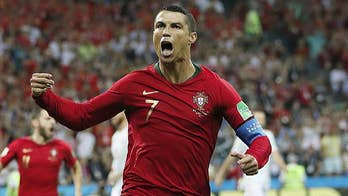 Portugal's Ronaldo nets hat-trick against Spain; Jonathan Hunt reports.