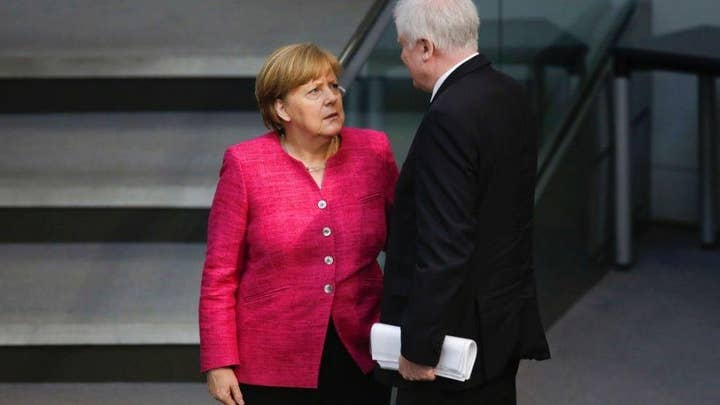 Angela Merkel at odds with coalition partners over migrants