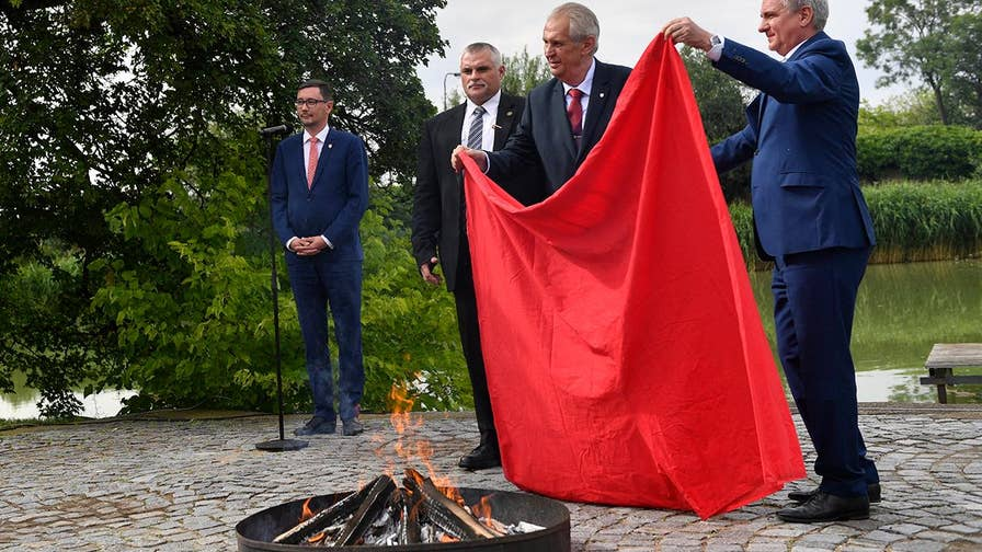 Raw video: At a bizarre press conference, Czech President Milos Zeman tells reporters he's 'sorry to make you look like little idiots, you really don't deserve it,' before burning a laughably large pair of underpants.